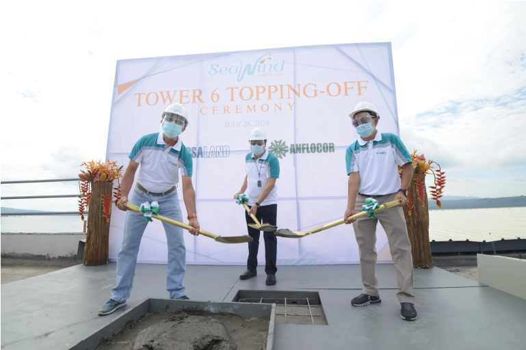 Leading the Topping-off ceremony are members of the management of the Anflo Group of Companies (l-r) Engr. Ruel A. Tan, Oscar V. Grapa, and Alfred E. Samson.