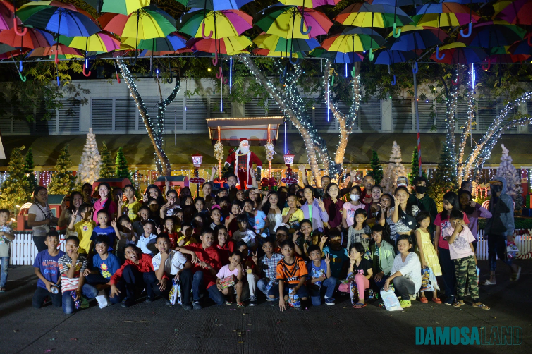The children from the orphanages pose with other children and officials of the Damosa Land Inc. and its guests during the Christmas lighting of the company's Christmas Village.