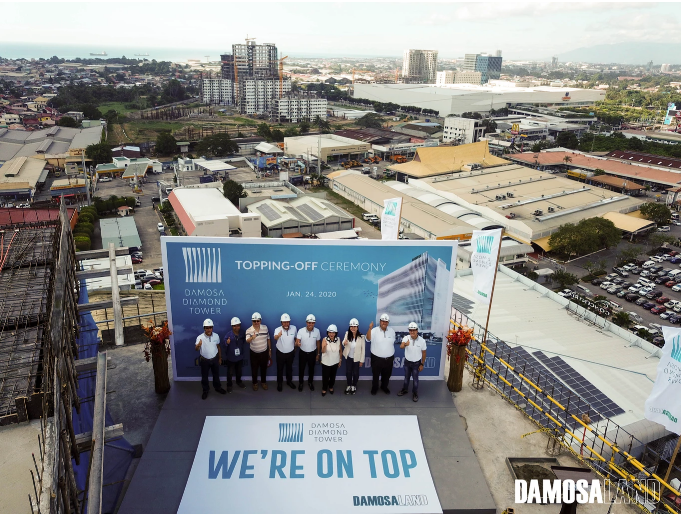 Damosa Land tops off the Damosa Diamond Tower, the company's newest contribution to Davao's interesting skyline, which was inspired by their heritage and the region's main product, banana. Present in the topping-off ceremony held recently are [L-R] Engr. Ruel A. Tan, Vice President, Anflo Construction Corporation; Christian Cambaya, Investor and Servicing Unit Head, Davao City Investment Promotion Center (DCIPC); Willy T. Ho, President, Carwill; Oscar V. Grapa, President, Management, Investment, Financing, and Security Companies of the Anflo Group; Ricardo F. Lagdameo, First Vice President, Damosa Land Inc.; Linda F. Lagdameo, Chairwoman of the Board, Anflo Group; Cathy Saldana, Managing Director, PDP Architects; Ricardo R. Floirendo, President, Real Estate and Livestock Operations of the Anflo Group; Vincent R. Floirendo, President, Agri Operations of the Anflo Group of Companies